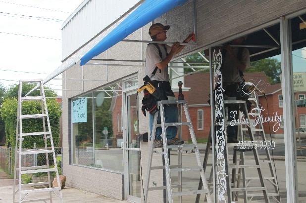 Company Makes Adjustment Awning Installation Building