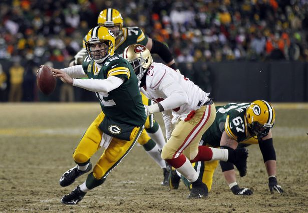 Green Bay Packers Quarterback Aaron Rodgers Scrambles During The