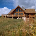 Handcrafted Log Home Railing Stone Fireplace Wildflowers