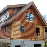 Into The Proper Openings And Log Siding Was Placedon Gable Ends