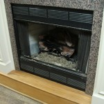 Prefabricated Fireplace Wiht Gas Logs Installed And Hanging Mesh