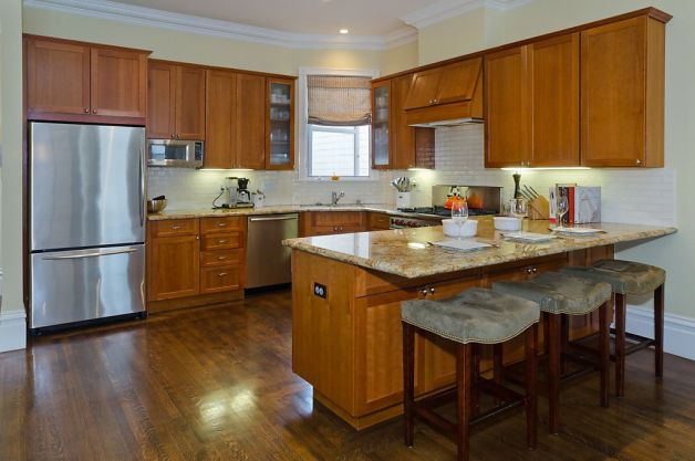 The Breakfast Bar And Remodeled Kitchen Features Stainless Steel