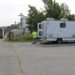 Two Ecbc Cbarr Employees Discuss Operations Outside Rtap Vehicle