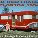 Woman Sits Outside Her Lipstick Red Mobile Home Trailer