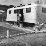 Woman Watching Her Playpen Outside Trailwood Mobile Home