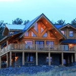 Wrap Around Deck Surrounds The Beautiful Log Home