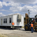 Description Fema Mobile Homes Being Placed Staging