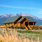 Handcrafted Log Home Exterior Decks Railing And Mountains