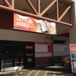 Hanging Over The Store Entrance Home Depot Promotes Their Mobile App