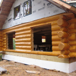 Log Home After Sanding Borating Caulking And Staining