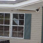 Mobile Home Sustained Broken Windows From The Wind And Debris