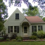 Small Home Steep Roof Cross Gable And Rounded Arch Front
