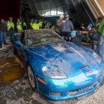 Workers Look After Extracting The Chevrolet Corvette Blue